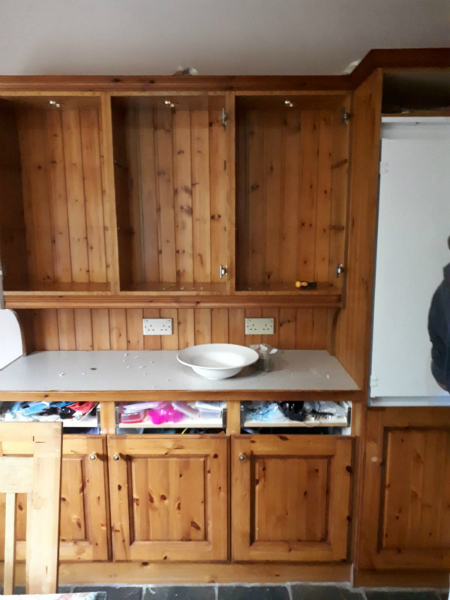 Wooden kitchen unit before renovation by bp Painters and decorators