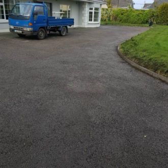 Drive way after power-washing work by bp painters and decorators
