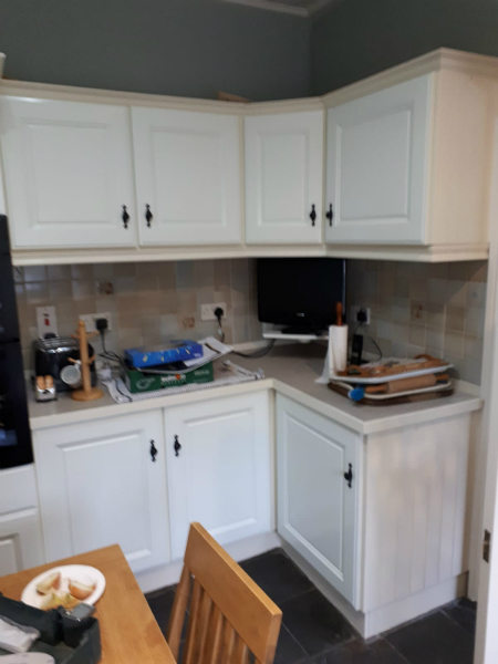 Wooden kitchen unit after painting work by bp painters and decorators