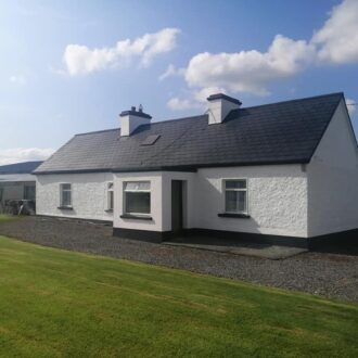 outside walls of a house after renovation by bp painters and decorators